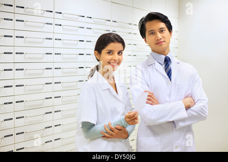 Portrait of two pharmacists in pharmacy - Stock Photo