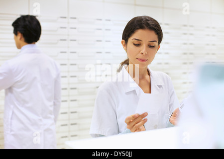 Pharmacists collecting prescription in pharmacy - Stock Photo