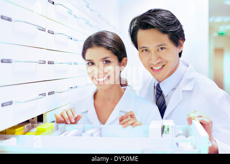 portrait of pharmacist and trainee in pharmacy stock photo - Pharmacist Trainee