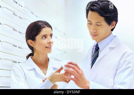 Pharmacists checking medication in pharmacy - Stock Photo