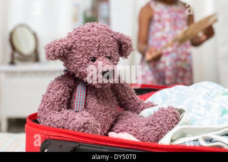 Teddy bear in open suitcase - Stock Photo