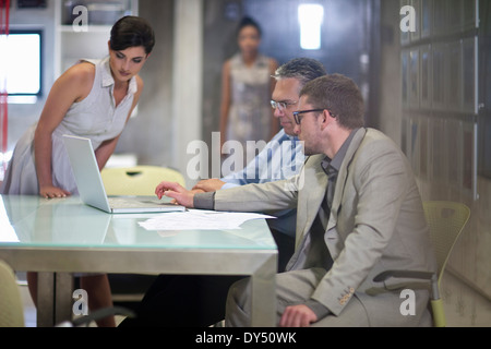 Young businessman presenting strategy to colleagues - Stock Photo
