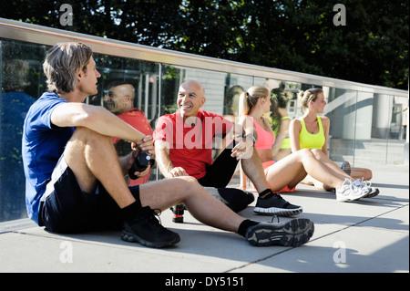 Runners taking break - Stock Photo