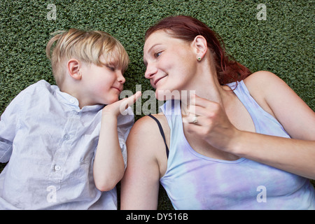 Boy blowing kiss to mother - Stock Photo