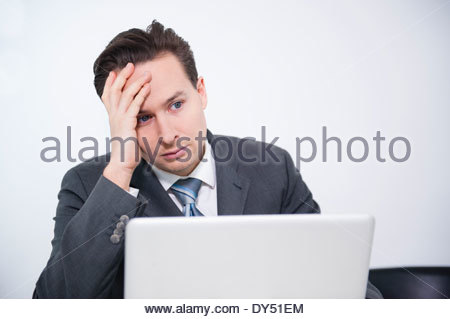 Businessman stressed out in office - Stock Photo
