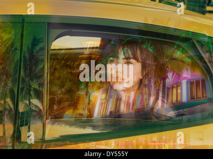 Young woman in back of taxi - Stock Photo