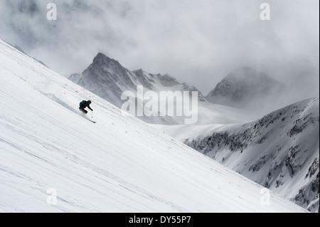 Mid adult man skiing down steep hill, Obergurgl, Austria - Stock Photo