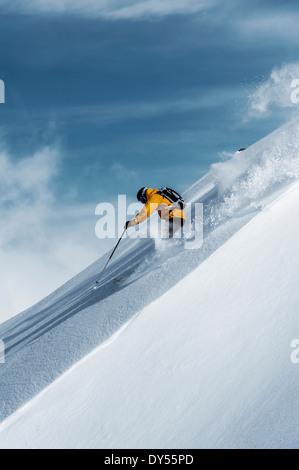 Mid adult male skier speeding downhill, Obergurgl, Austria - Stock Photo