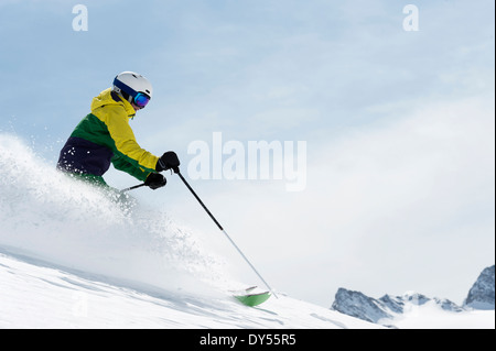 Young woman skiing downhill, Obergurgl, Austria - Stock Photo