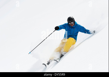 Mid adult man skiing downhill, Obergurgl, Austria - Stock Photo