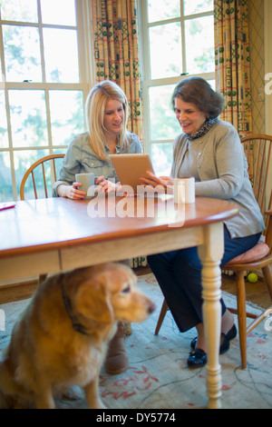 Senior woman and granddaughter using digital tablet - Stock Photo