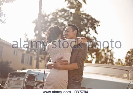 Affectionate couple hugging on the street - Stock Photo
