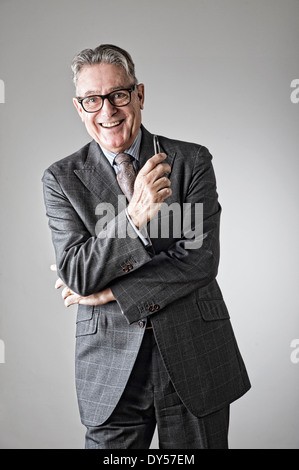 Portrait of senior man, wearing suit - Stock Photo