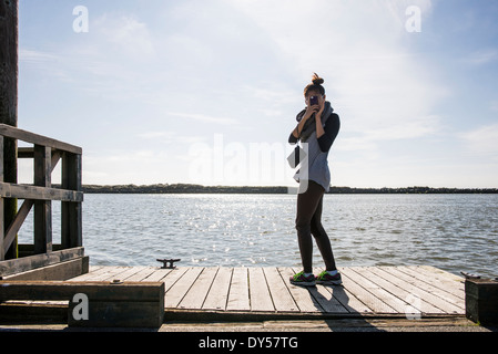 Young woman photographing with digital camera, Richmond, British Columbia, Canada - Stock Photo