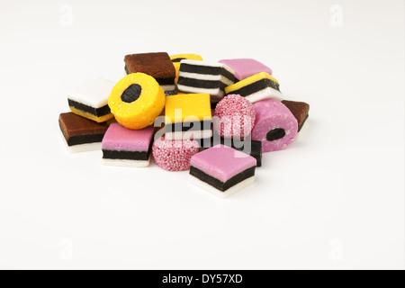 Liquorice allsorts fondant and liquorice sweets or candy studio isolated - Stock Photo
