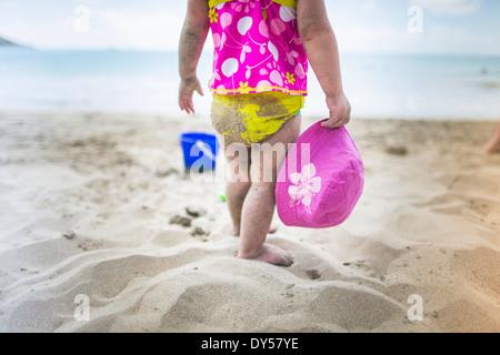 Baby playing on sandy beach - Stock Photo