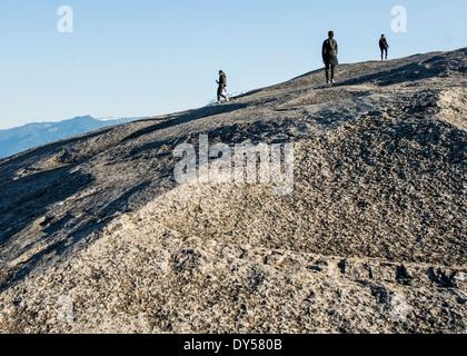 Three young female hikers on rock, Squamish, British Columbia, Canada - Stock Photo
