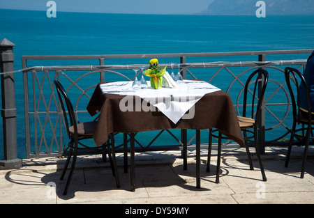 table in a restaurant on the sea - Stock Photo