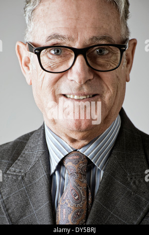 Portrait of senior man, wearing suit and tie - Stock Photo