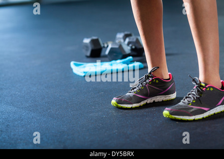 Sports shoes, weights, towel - Stock Photo
