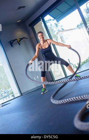 Young woman working out with rope - Stock Photo