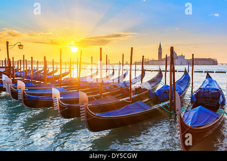 Venetian gondolas at sunrise - Stock Photo