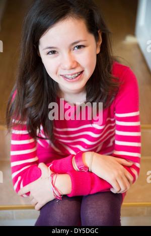 Portrait of girl with dental brace, smiling
