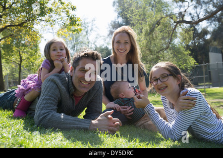 Happy family relaxing on grass - Stock Photo