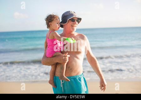 Grandfather and granddaughter on beach - Stock Photo
