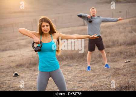 Couple working out with weights - Stock Photo