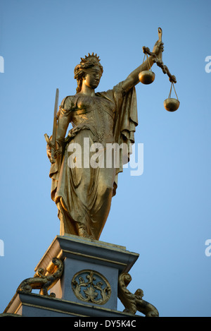 BRUGES, Belgium - Gold statue of Justice on top of the Oude Griffie building (Old Office, or Old Recorders House) - Stock Photo