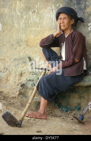 North Vietnamese peasant woman rests after hard day's work in fields of North Vietnam in the 1980s - Stock Photo