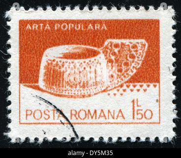 ROMANIA - CIRCA 1982: A stamp printed in the Romania, shows a wooden ladle from Valea Mare, circa 1982 - Stock Photo