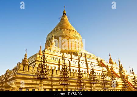Shwezigon Pagoda or Shwezigon Paya at early morning in Bagan, Burma - Stock Photo