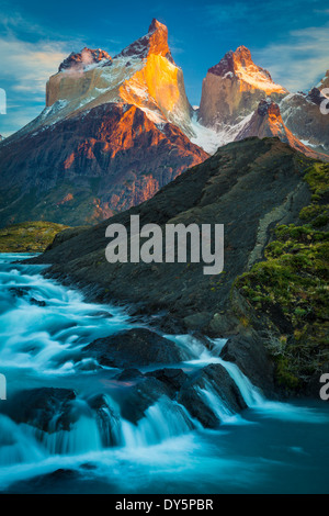 Los Cuernos towering above a cascade near Lago Nordenskjold in Torres del Paine, Chilean part of Patagonia - Stock Photo