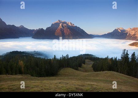 View over the fog in the valley onto Hochkalter and Reiteralpe, Berchtesgaden region, Berchtesgaden National Park, - Stock Photo
