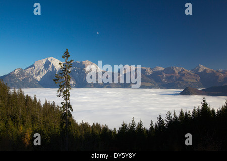 View over the fog in the valley to Hoher Goell and Hohes Brett in the moonlight, Berchtesgaden region, Berchtesgaden - Stock Photo
