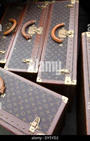 Large Louis Vuitton Suitcases for Sale at Portobello Market on Ladbroke Gardens - London W11 - UK - Stock Photo