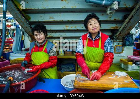 Women selling fish at the modern fish market in Busan, South Korea, Asia - Stock Photo