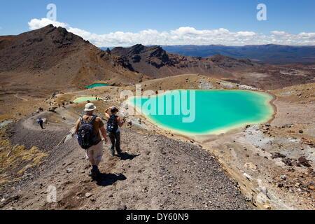 Walkers and Emerald Lakes on the Tongariro Alpine Crossing, Tongariro National Park, UNESCO Site, North Island, - Stock Photo