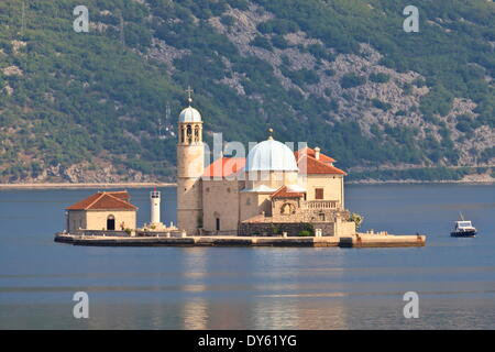 Gospa od Skrpjela (Our Lady of the Rocks) island, lit by early morning light, near Perast, Bay of Kotor, Montenegro - Stock Photo