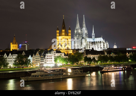 View over river Rhine to old town, Heumarkt with cathedral and Great St. Martin church, Cologne, North Rhine-Westphalia, - Stock Photo