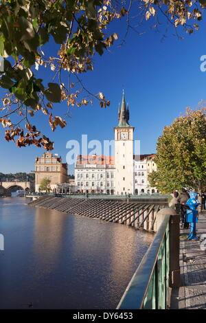 View over the River Vltava to Smetana Museum and Charles Bridge, Prague, Bohemia, Czech Republic, Europe - Stock Photo