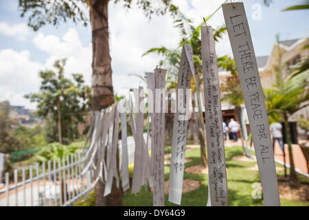 Kigali, Rwanda. 6th April 2014. Messages written on ribbons hanging outside the Kigali Genocide Memorial Centre. - Stock Photo
