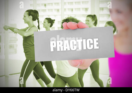Fit blonde holding card saying practice - Stock Photo