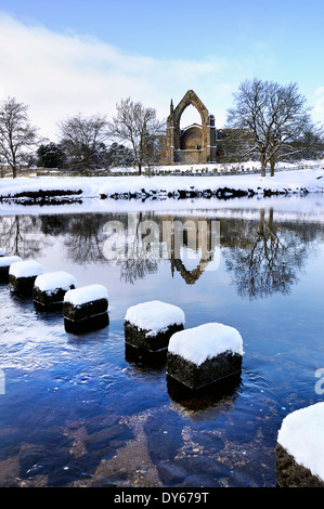 bolton priory and stepping stones in snow - Stock Photo