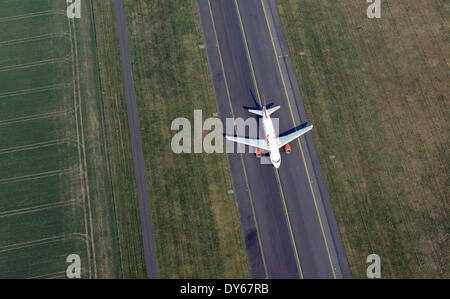 Berlin, Germany. 29th Mar, 2014. An aircraft of the British airline easyJet goes along the runway before taking - Stock Photo