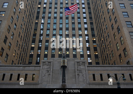 The American flag flying in front of the Graybar building on Lexington Avenue  & East 44th in midtown Manhattan, - Stock Photo