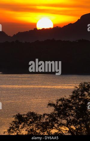 Sunset over the Kandalama Reservoir in Dambulla, Sri Lanka - Stock Photo