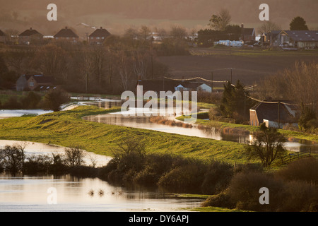 View of the River Parrett with water pouring over its banks into Southlake Moor during the flooding of the Somerset - Stock Photo